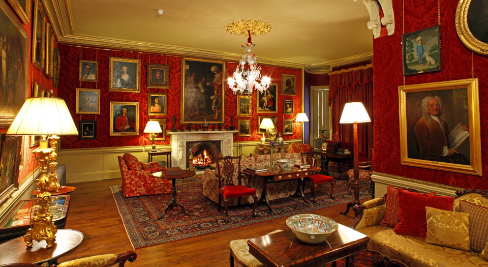 Aldourie Castle Red Drawing Room is the social hub of the property
