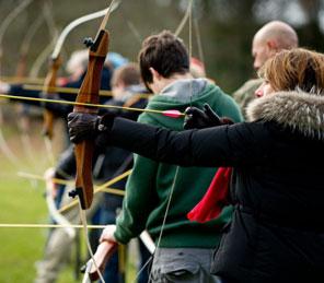 people playing archery exclusive use Scottish castle | teambuilding event Aldourie Castle Estate Loch Ness