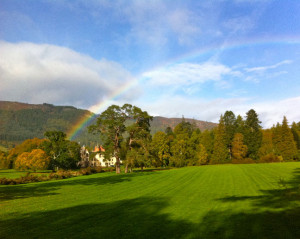 rainbow over aldourie castle parkland