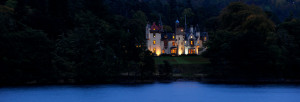 Castle on Loch Ness lit at night wide angle exclusive use Aldourie Castle Estate Scottish Highlands