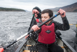 boy and girl canoeing Loch Ness Aldourie Castle Estate exclusive use