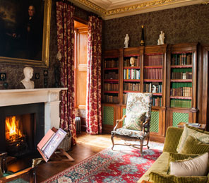 cosy library with fireplace burning | Aldourie Castle Loch Ness
