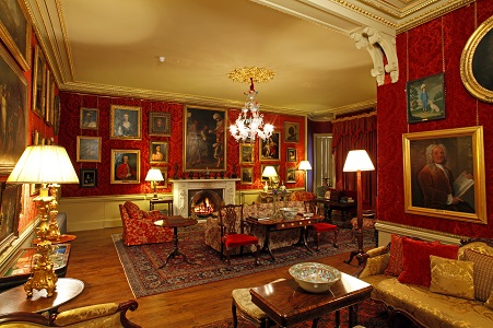 9. Aldourie Castle - Red Drawing Room at night corporate