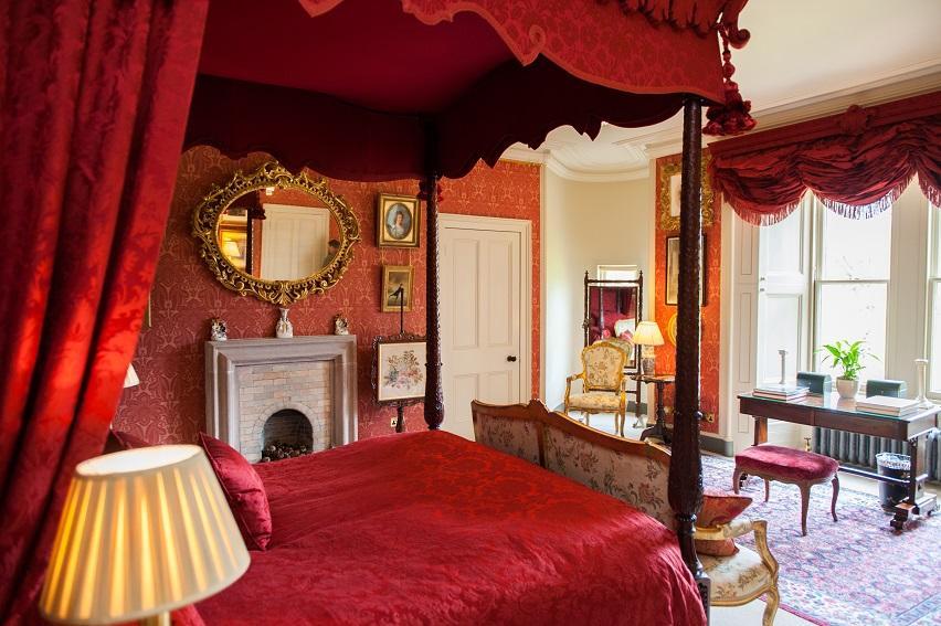 luxury bedroom Aldourie Castle four-poster bed