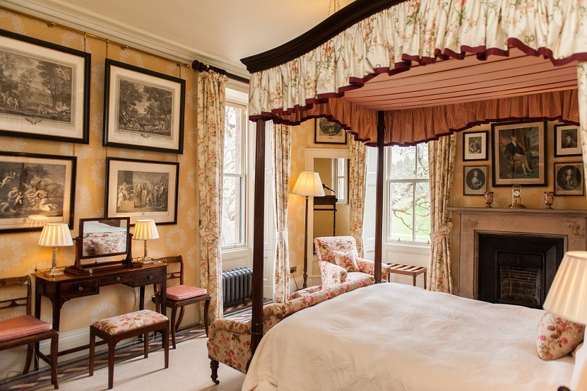 luxury bedroom Aldourie Castle four-poster bed