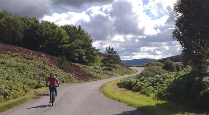 Man Cycling in the Highlands best cottage holiday tours near Inverness